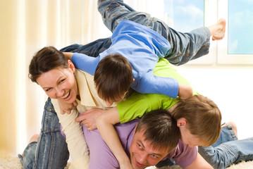 Happy family fun playing