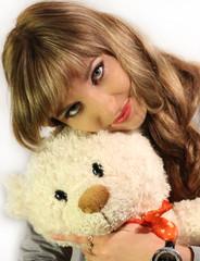beautiful brunette girl holding a bear
