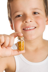 Little boy holding small bottle of pollen