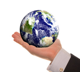 Earth in hands over white background