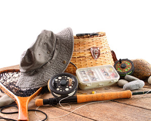 Fly fishing equipment on white