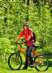 Young cyclist in the wood