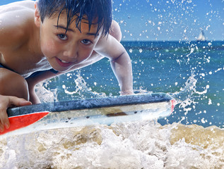 child riding a bodyboard