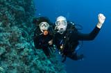 couple scuba diving poster