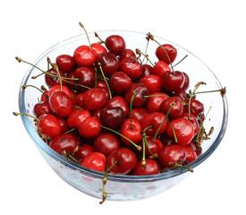 sweet cherries in glass plate