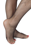 Woman feet with fishnet tights isolated over white background