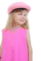 Beautiful little girl in a pink cap.
