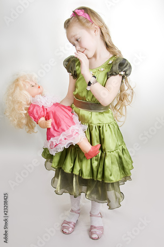 The girl plays with a doll