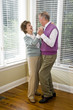 Loving senior couple dancing in living room