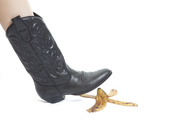Woman's foot about to slip on banana peel