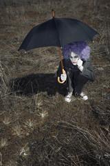 Clown and umbrella