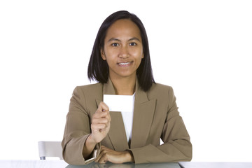 Businesswoman at Her Desk Holding a Blank Business Card