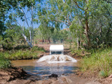 Campervan crossing river in Australia