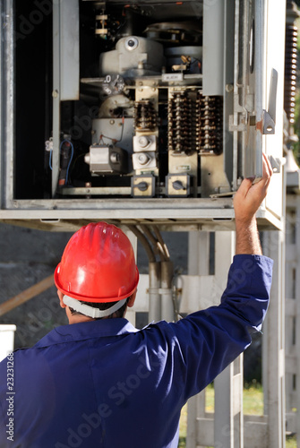 Electrician inspecting wires in electric panel