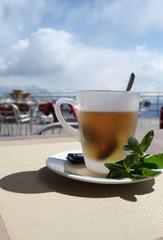 Hot Teacup in Restaurant in Alps
