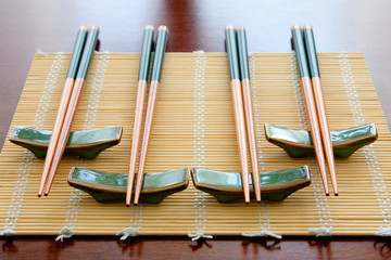 Chopsticks on table mat