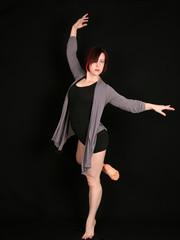 woman dancer on black background