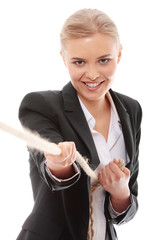 Businesswoman pulling on a piece of rope