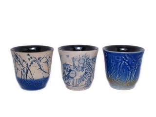 three ceramic cups