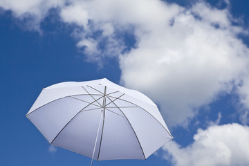 White umbrella under cloudy sky