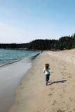 Little Girl running on beautiful beach in newfoundland poster