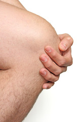 male knee with hand on white background