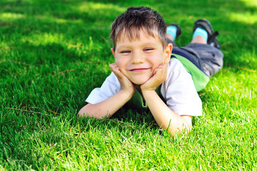happy little boy on the grass