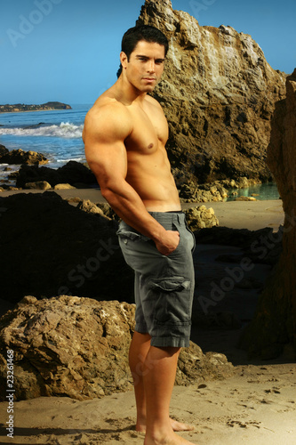 Goodlooking male model by the beach