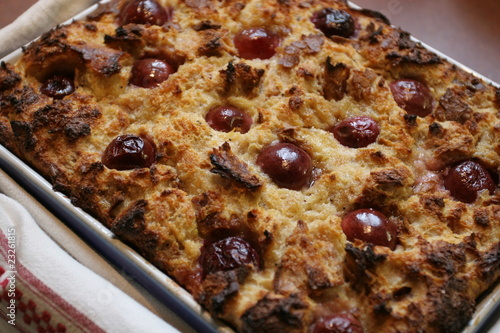 Soufflé with bread and cherries, baked pastries - 23261815