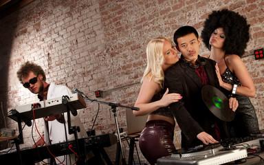 Pretty Ladies Surrounding a DJ