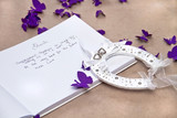 Opened Wedding Guest Book with a Good Luck Horseshoe poster