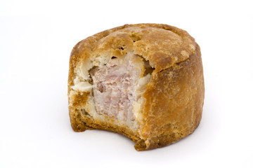 small pork pie with bite taken