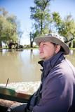 Man in a boat in Danube Delta poster