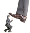 Businessman is kicking by a big foot