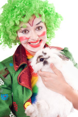 Female clown with a white rabbit