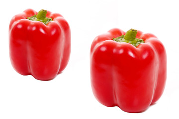 Two red paprikas isolated on white, studio shot