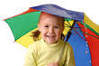 Cute child catching raindrops under umbrella