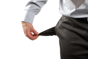 Disappointed businessman with empty pockets isolated over white