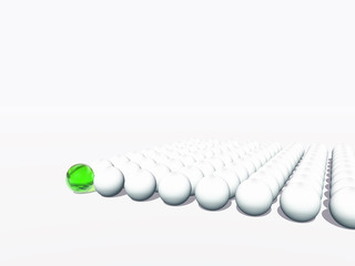 Conceptual crowd of spheres with one green glass sphere