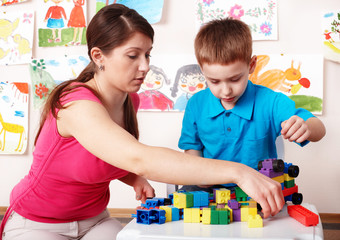 Child play construction  with mother.