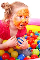 Little girl play colourful balls.