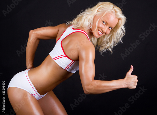 Sportswoman showing super sign