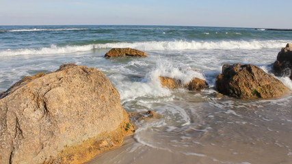 Sea waves on the rocky shoreline (Full HD)