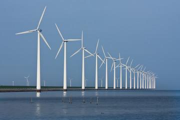Row of windmills, mirrored in the Dutch sea