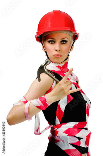 A girl with a hammer and a construction helmet