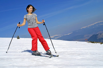 Girl skiing on a mountain slope