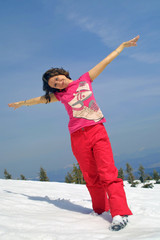 Happy girl relax on a mountain slope