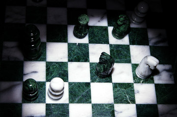 assorted chess pieces arranged on the board