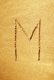 Alphabet letter handwritten in sand on a beautiful beach poster