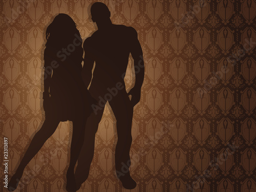 Sexy couple against damask background.